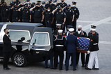 Photo - The casket of US Capitol Police officer William Evans who was killed in the line of duty on April 2 is loaded onto a vehicle as it departs the US Capitol following ceremonies in his honor in Washington US April 13 2021Credit Carlos Barria  Pool via CNPAdMedia
