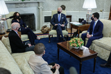 Photos From U.S. President Joe Biden, U.S. Vice President Kamala Harris and Pete Buttigieg wear protective masks during a meeting on infrastructure with House members in the Oval Office of the White House in Washington
