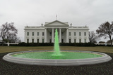 Photos From The fountain on the North Lawn of the White House illuminated in green light in celebration of Saint Patrick's Day