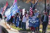 Photo - Demonstrators Line the street as United States President Donald Trump Departs Trump National Golf Club