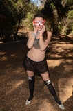 Photos From Alicia Arden in costume at a Dia De Los Muertos festival