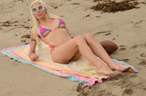 Photo - Frenchy Morgan plays football in a barely-there bikini