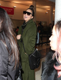 Photos From Chrissy Teigen is seen at LAX Airport