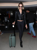 Photos From Hailey Clauson is seen at LAX Airport