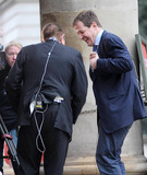 Alastair Campbell Photo - Scottish journalist and broadcaster Andrew Neil 61 and British broadcaster and political aide Alastair Campbell have a good chuckle as Alastair fiddles with his earpieces and microphone before recording a brief interview outside of the BBC Broadcasting House  Later the pair leave the building together while chatting London UK 012211