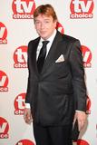 Adam Woodyatt Photo - Adam Woodyatt arriving for the TV Choice Awards 2014 at the Hilton Park Lane London 08092014 Picture by Steve Vas  Featureflash