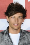 Photo - Louis Tomlinson from One Direction at the One Direction This is Us film - press conference London 19082013 Picture by Steve Vas  Featureflash