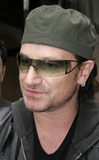Photos From Singer Bono Of The Rock Band U2 Signing Autographs In NYC