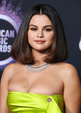 Roberto Coin Photo - LOS ANGELES CALIFORNIA USA - NOVEMBER 24 Singer Selena Gomez wearing a Versace dress and shoes with Roberto Coin jewelry arrives at the 2019 American Music Awards held at Microsoft Theatre LA Live on November 24 2019 in Los Angeles California United States (Photo by Xavier CollinImage Press Agency)