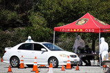 Photos From Coronavirus COVID-19 Drive-Through Testing Site At Frank Hotchkin Memorial Training Center In Elysia